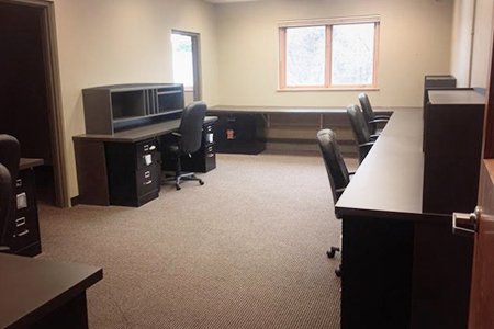 Office space for lease in Balsam Lake, Wisconsin, with built-in desks & file cabinets, move-in ready.