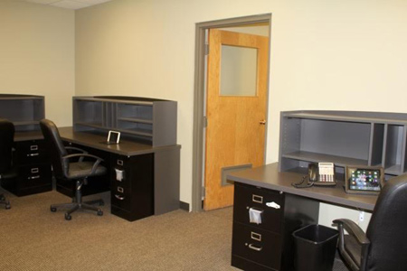 Ideal commercial office space for lease in Polk County, Wisconsin, built-in desks & file cabinets, move-in ready.