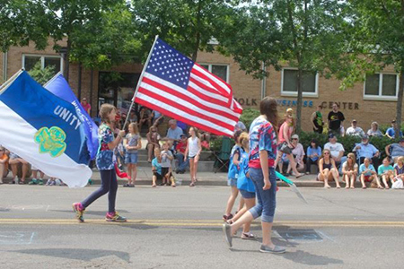 Parade in front of Polk Business Center commercial office space in Polk County, WI