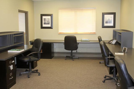 Ideal office space for lease in Balsam Lake, Wisconsin, built-in desks & file cabinets, move-in ready.